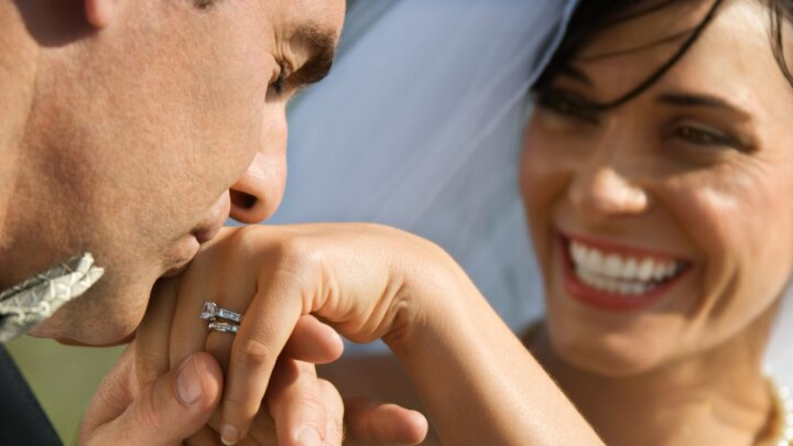 Groom Kissing Hand Of Smiling Bride Picture Id93388205 (1)